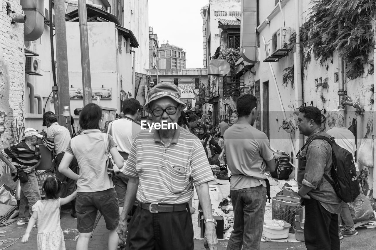 real people, building exterior, architecture, street, built structure, men, outdoors, casual clothing, city, large group of people, leisure activity, day, lifestyles, people