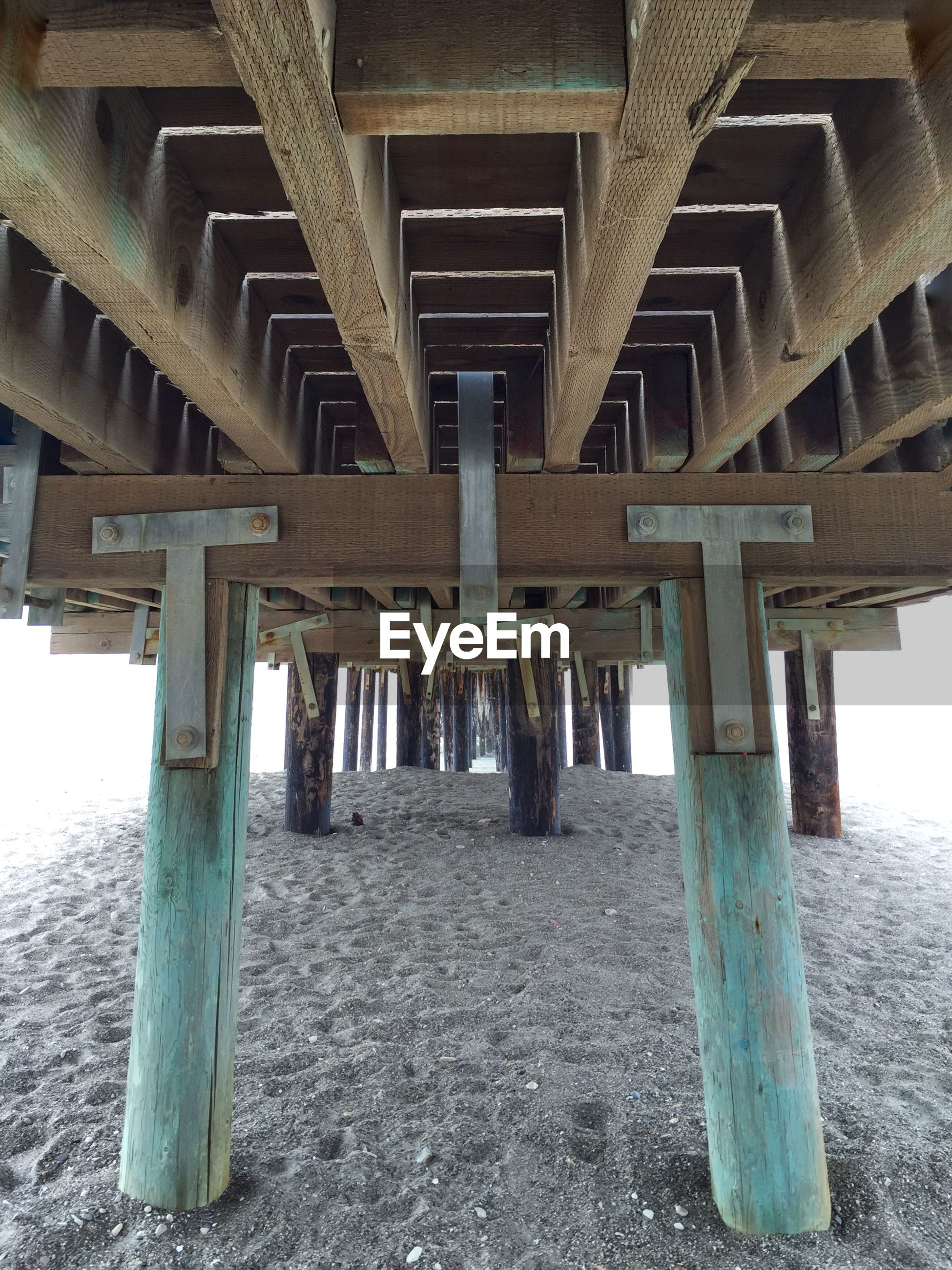 Low angle view of pier at beach