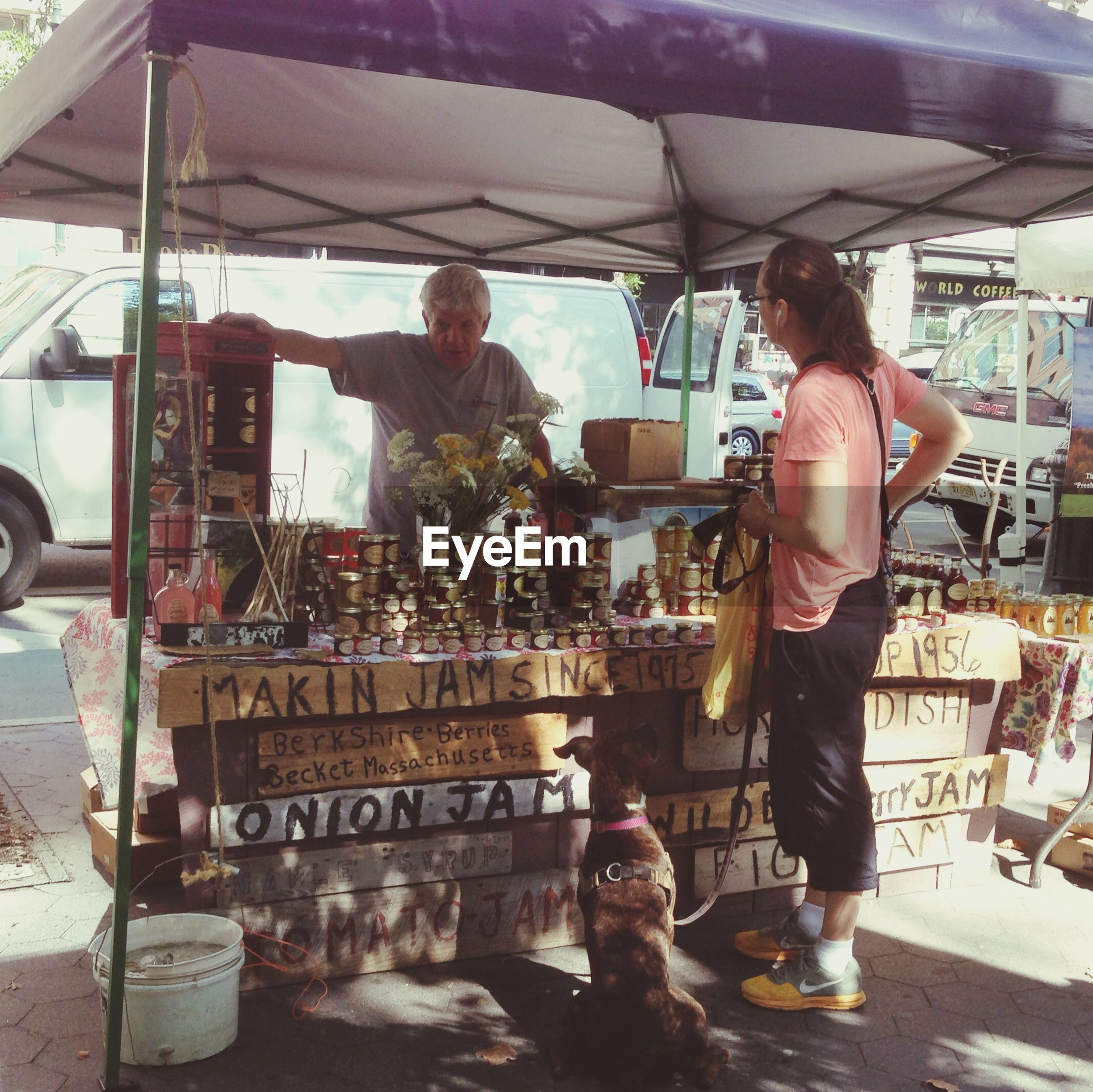lifestyles, text, men, leisure activity, communication, retail, person, casual clothing, market, building exterior, standing, food and drink, western script, market stall, built structure, store, architecture