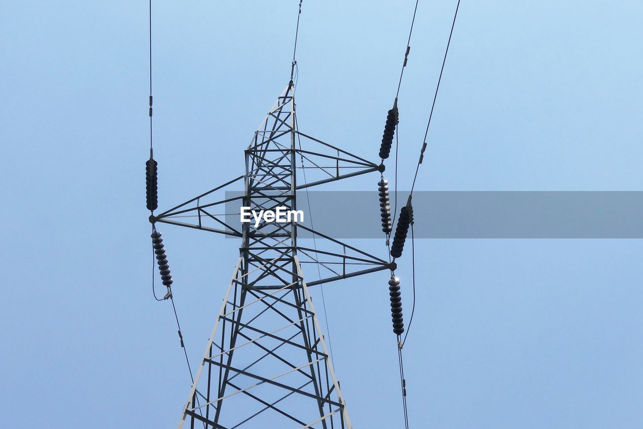 electricity, sky, low angle view, electricity pylon, clear sky, technology, fuel and power generation, connection, cable, power supply, nature, power line, blue, day, no people, architecture, built structure, copy space, tall - high, outdoors, global communications, directly below, girder, electrical equipment