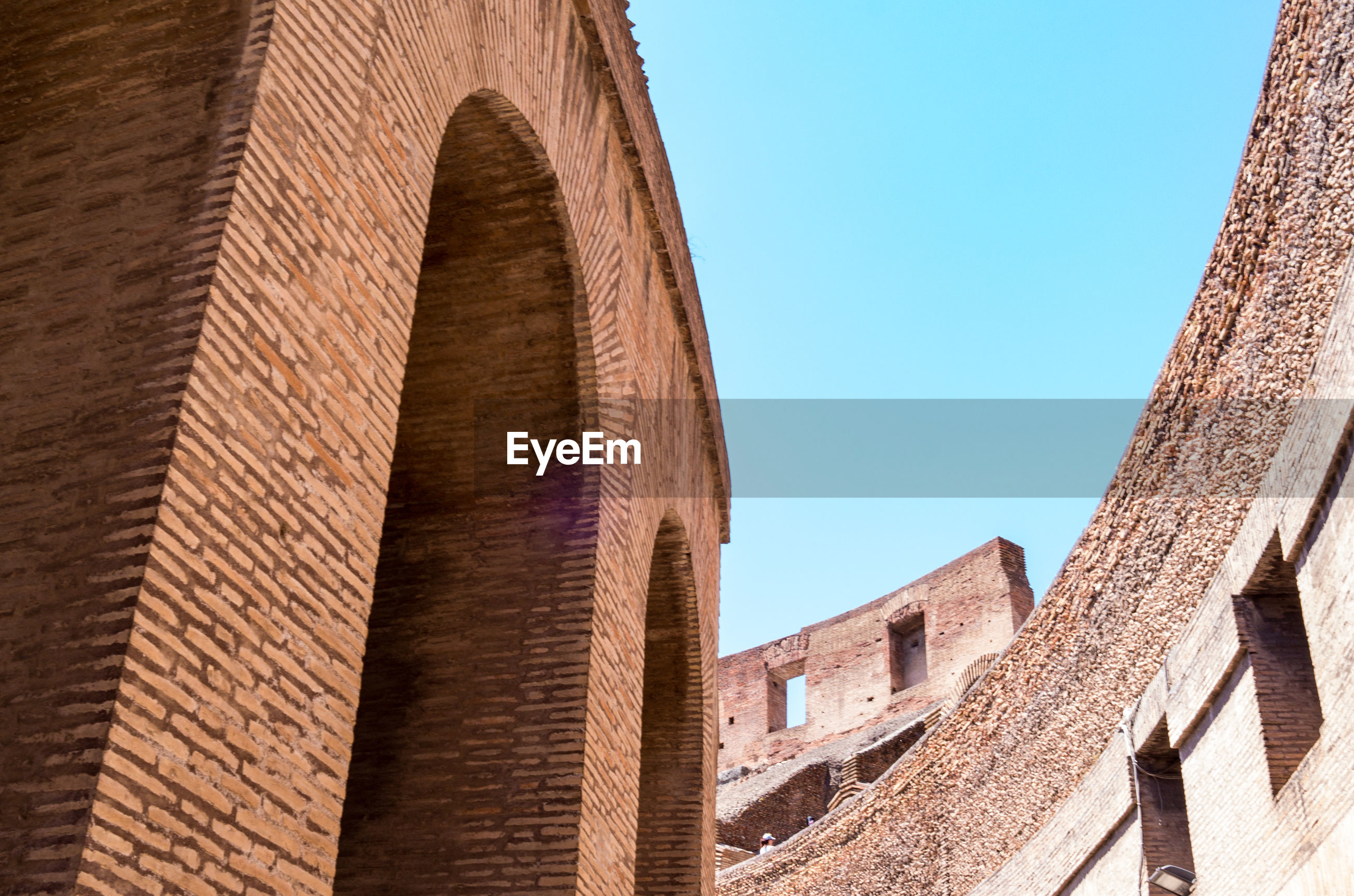 Low angle view of colosseum against clear sky