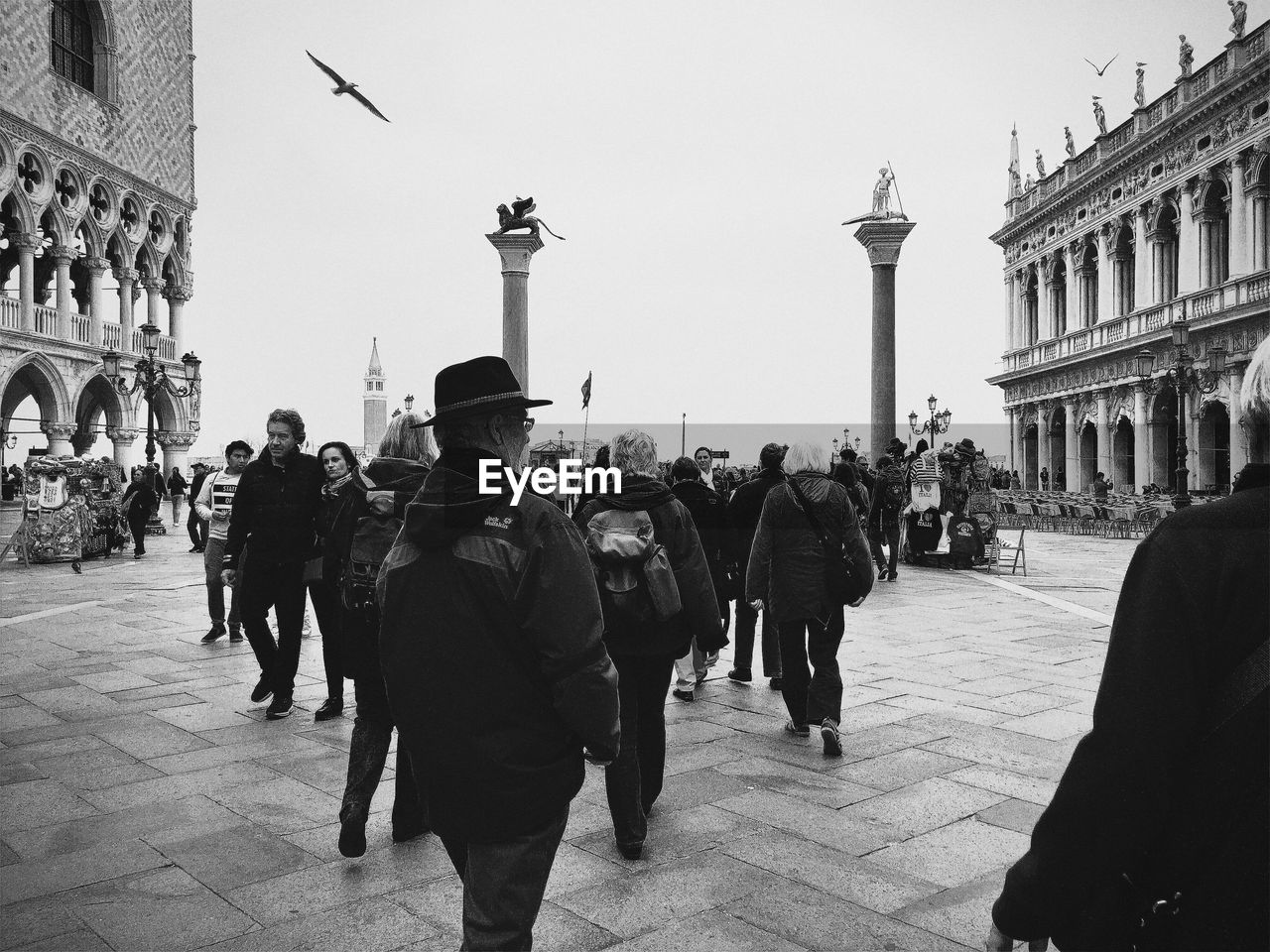 People at piazza san marco against sky in city