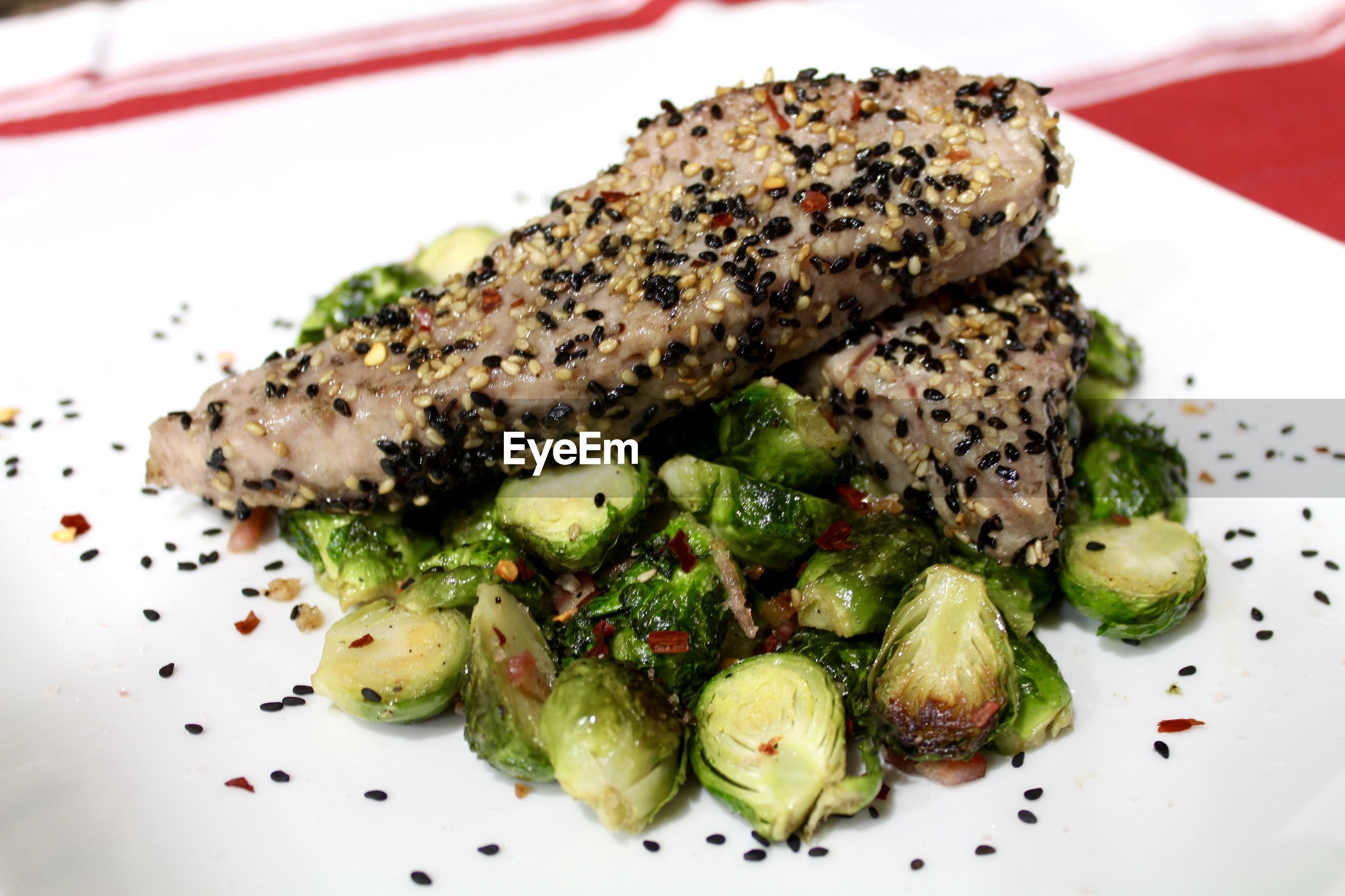 Close-up of tuna and brussels sprouts served in plate