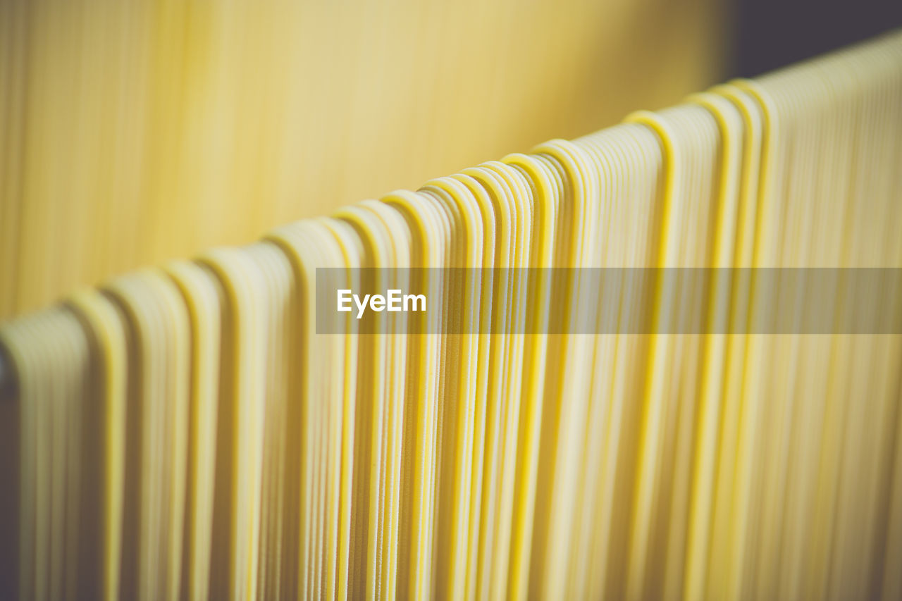 Close-up of spaghetti drying in factory