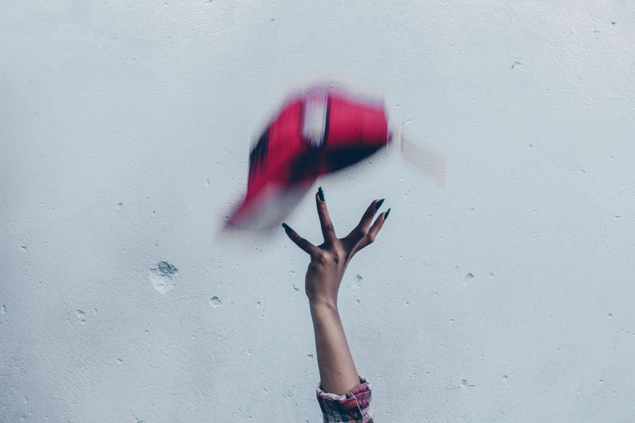 Close-Up Of Woman Throwing Baseball Cap