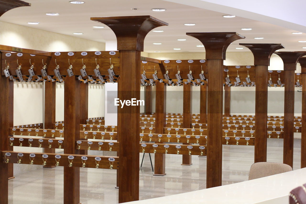 in a row, architectural column, indoors, no people, wood - material, drink, architecture, water, day