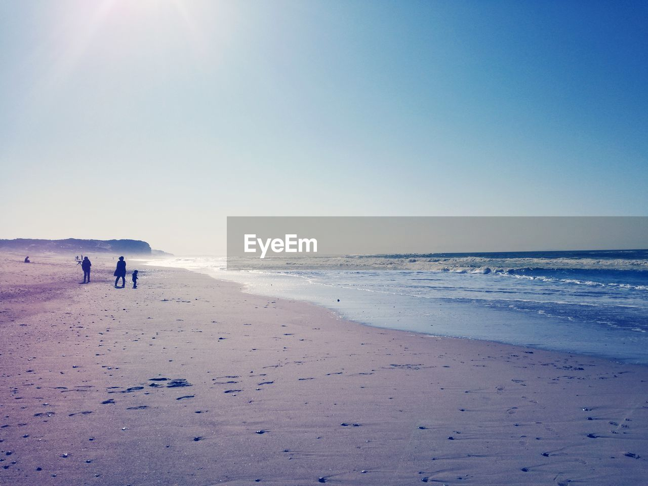 land, sea, beach, sky, water, beauty in nature, horizon, sand, horizon over water, scenics - nature, nature, tranquility, clear sky, tranquil scene, real people, holiday, sunlight, trip, day, outdoors