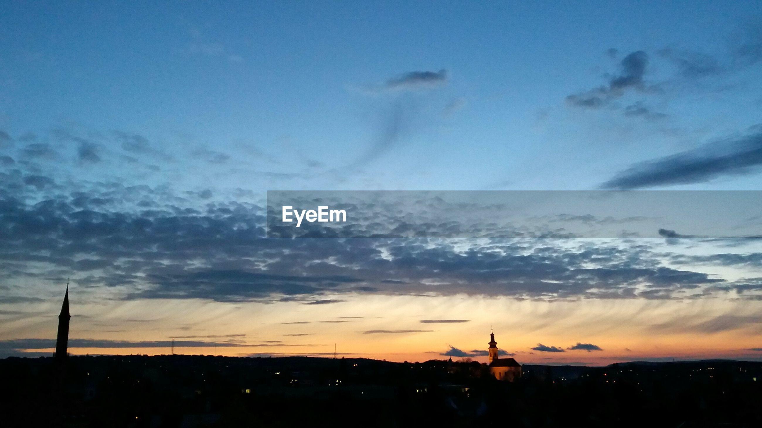 Silhouette eger against sky during sunset