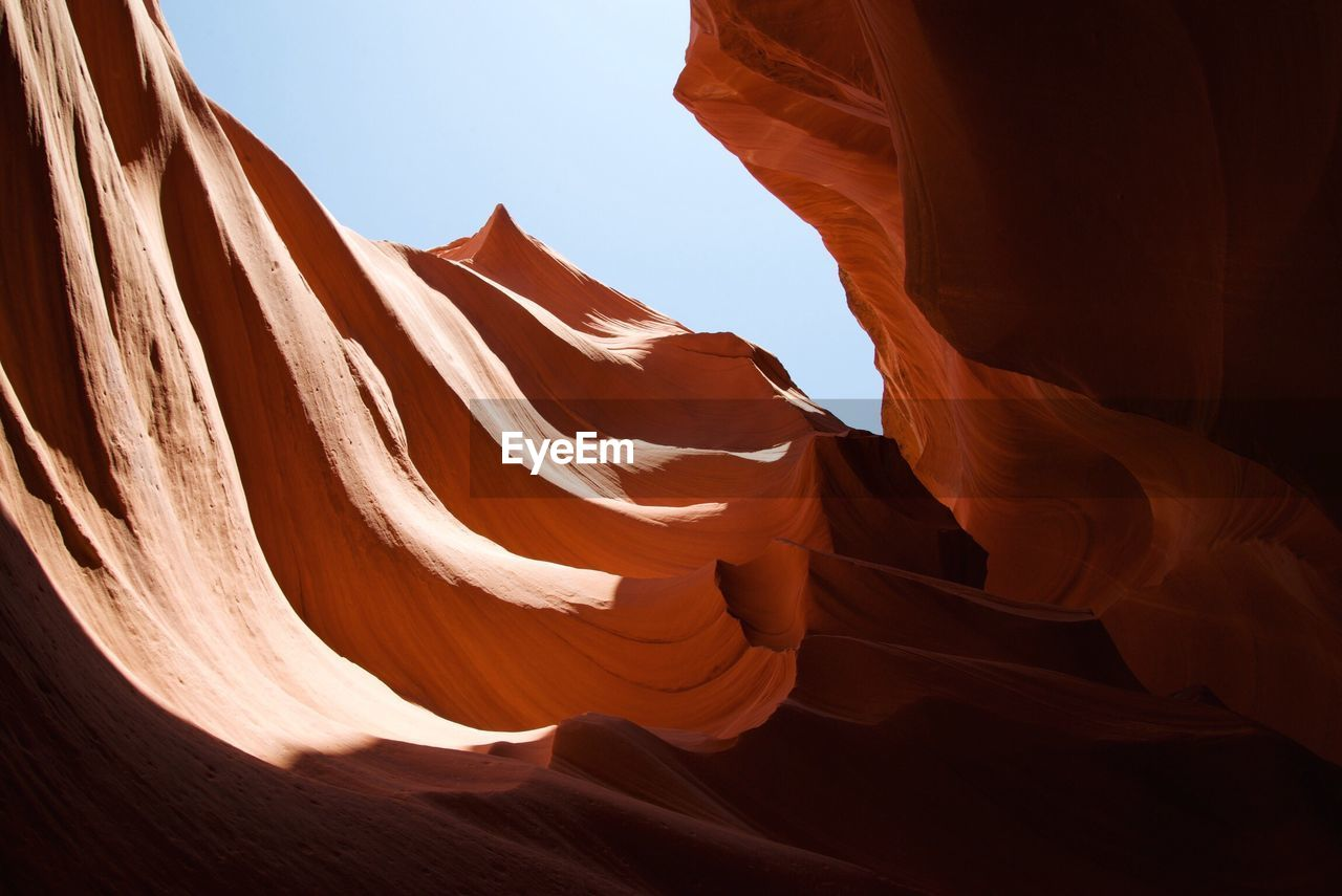 Low Angle View Of Rock Formations In Desert