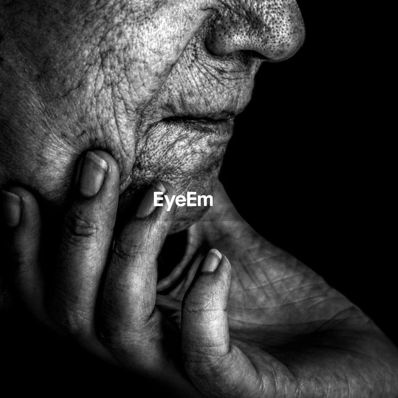 senior adult, human body part, wrinkled, senior men, human hand, one person, senior women, real people, black background, human skin, touching, close-up, men, bonding, eyesight, adult, adults only, people