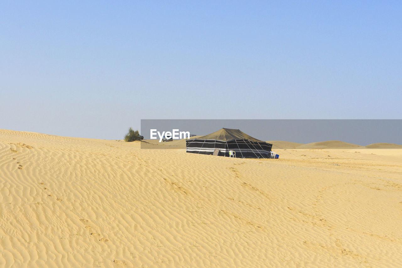 Tent In Desert Against Sky