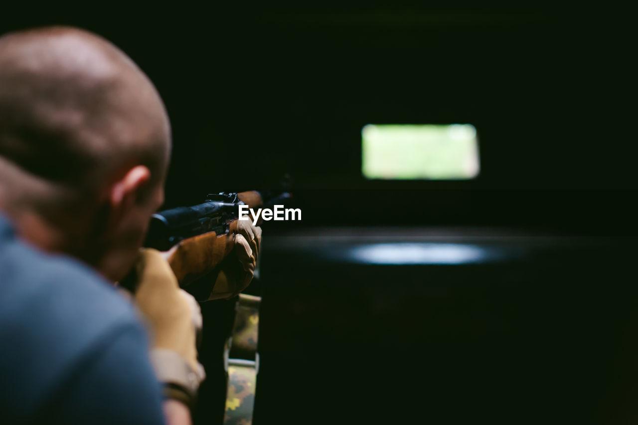 Man Using Rifle