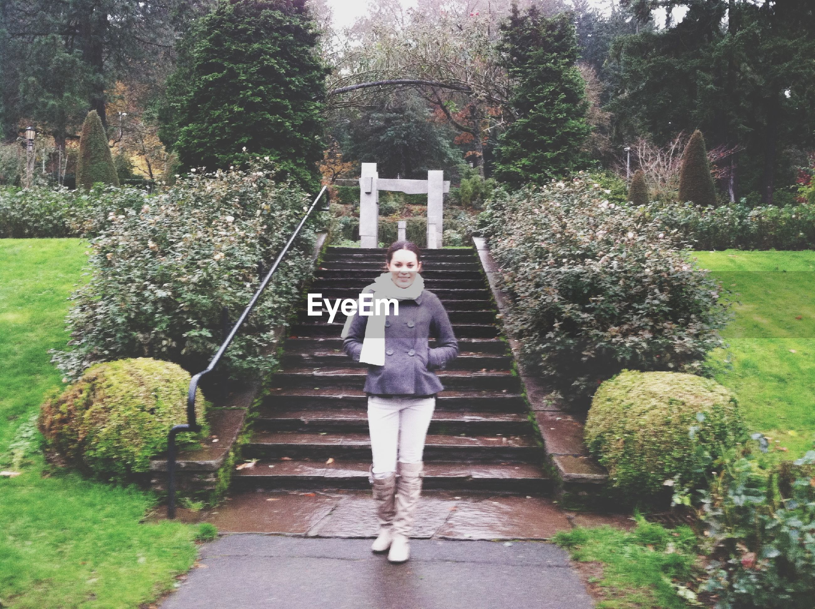 full length, tree, lifestyles, leisure activity, casual clothing, rear view, standing, growth, walking, person, the way forward, plant, young adult, young women, park - man made space, nature, steps