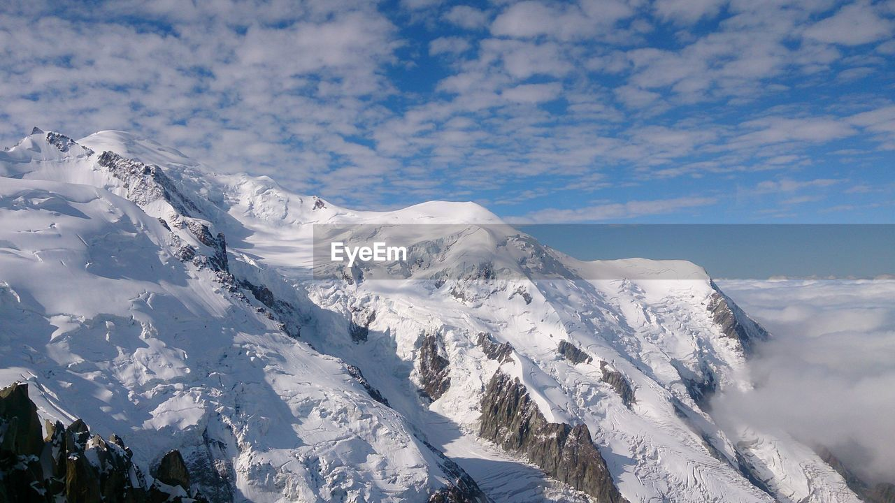 Low Angle View Of Snow Mountains Against Sky