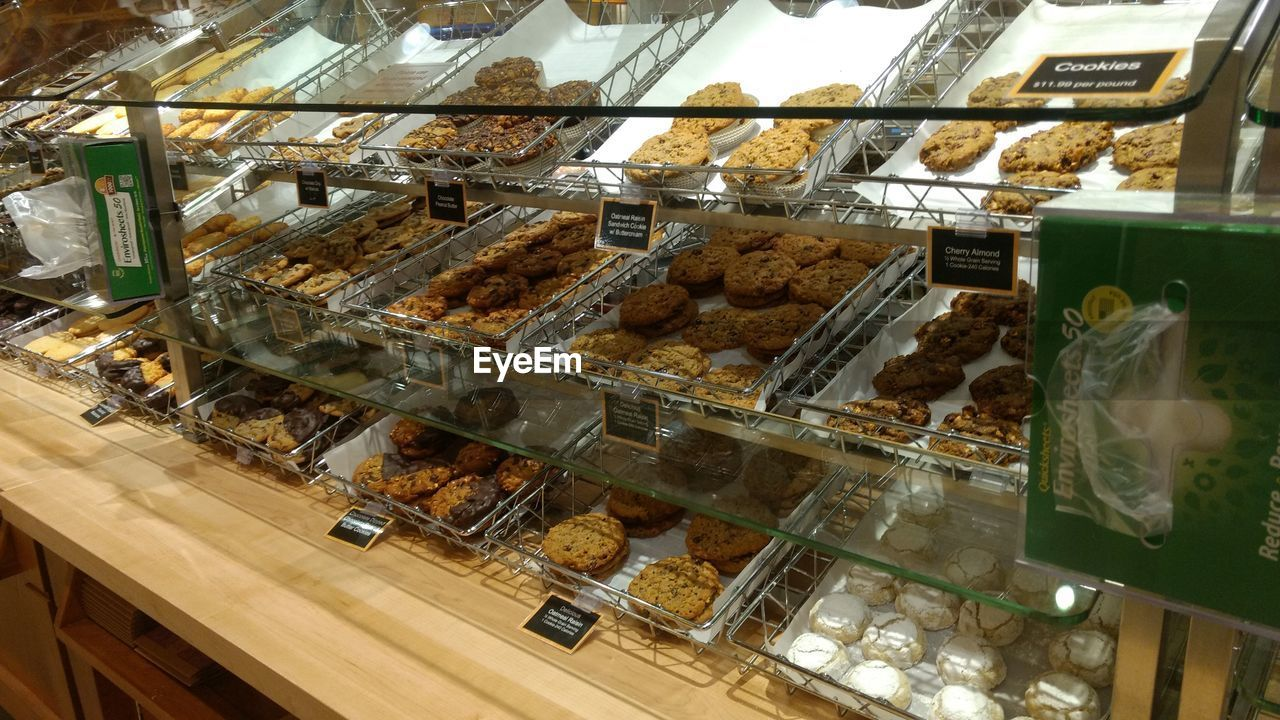 food and drink, indoors, dessert, food, indulgence, retail, sweet food, unhealthy eating, variation, display cabinet, store, choice, bakery, no people, frozen food, ice cream parlor, freshness, ready-to-eat, day, supermarket