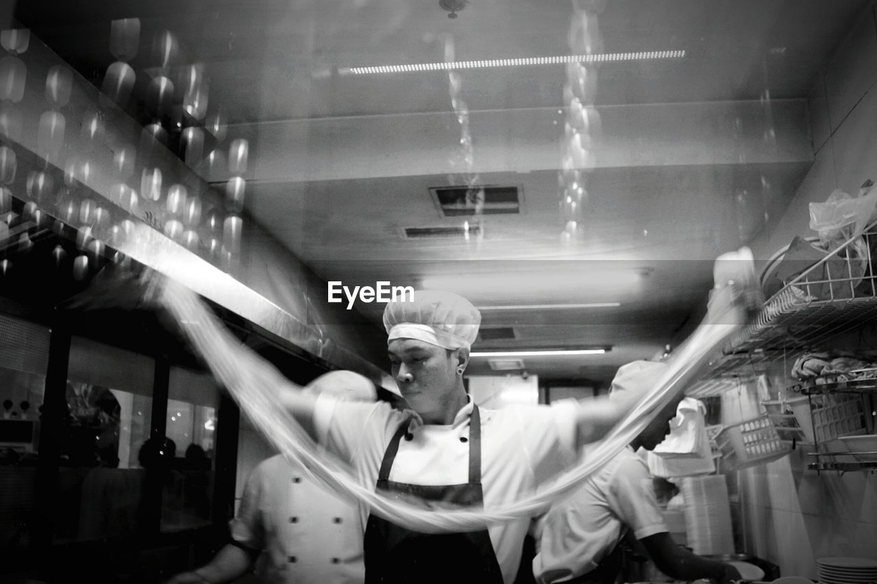 Midsection Of Man Working In A Restaurant Kitchen