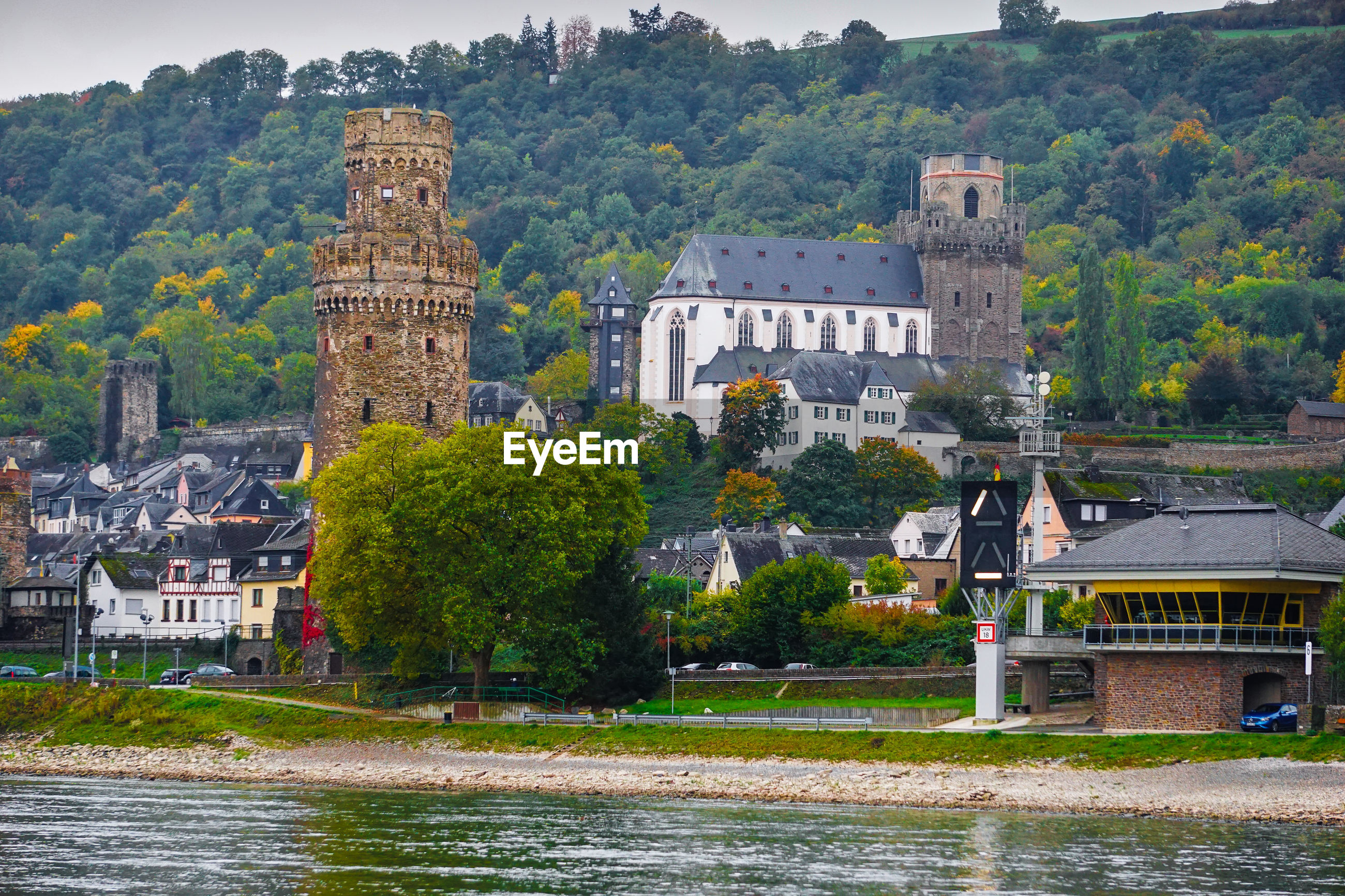 Town by rhine river against mountain