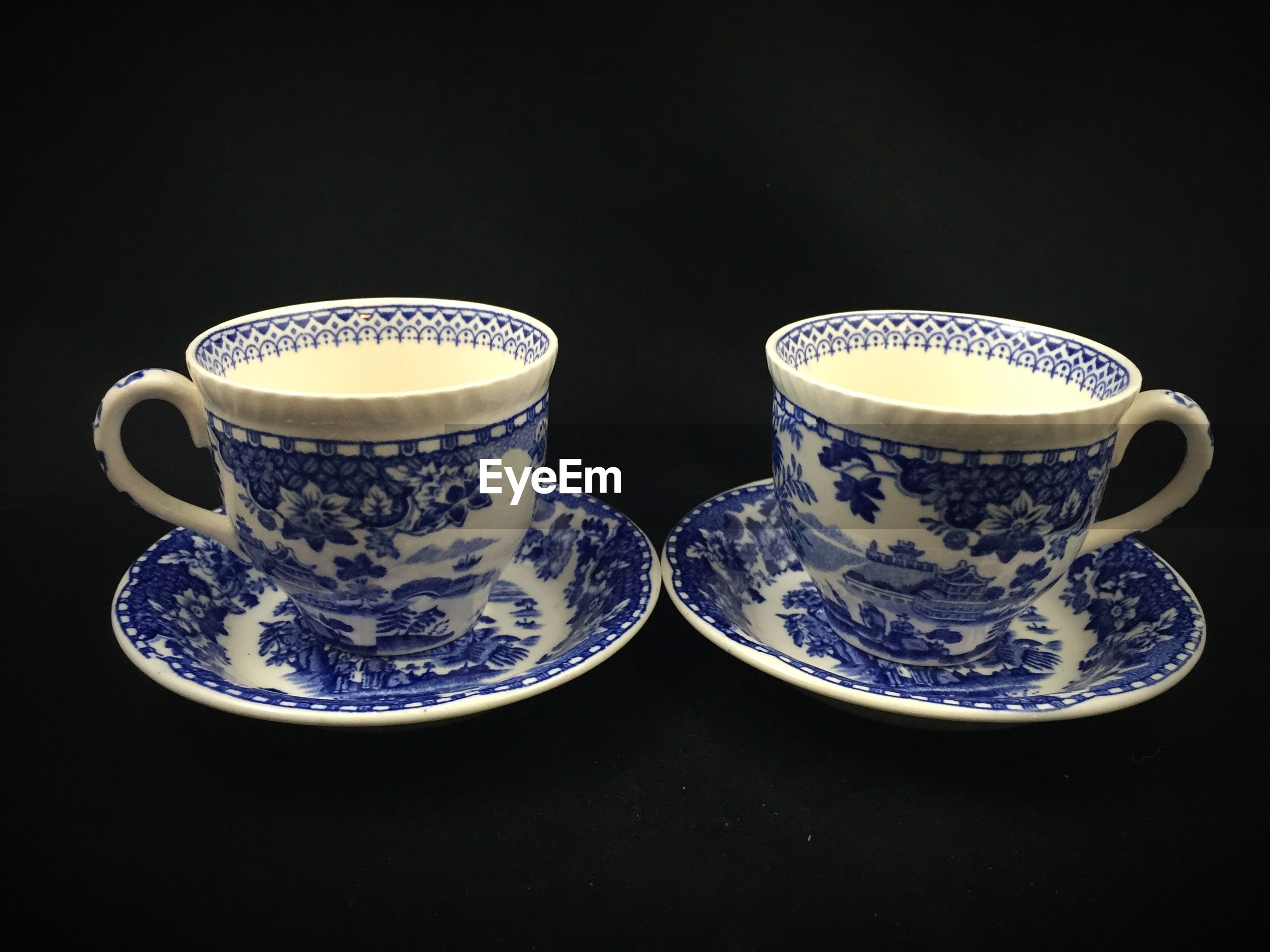 CLOSE-UP OF TEA CUP AND TABLE