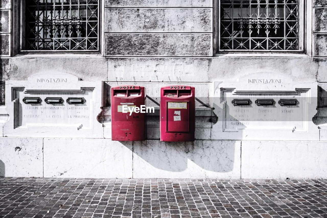 built structure, architecture, building exterior, wall - building feature, connection, no people, day, red, safety, technology, communication, outdoors, mailbox, security, wall, emergency equipment, electricity, protection, window, public mailbox, fire hose