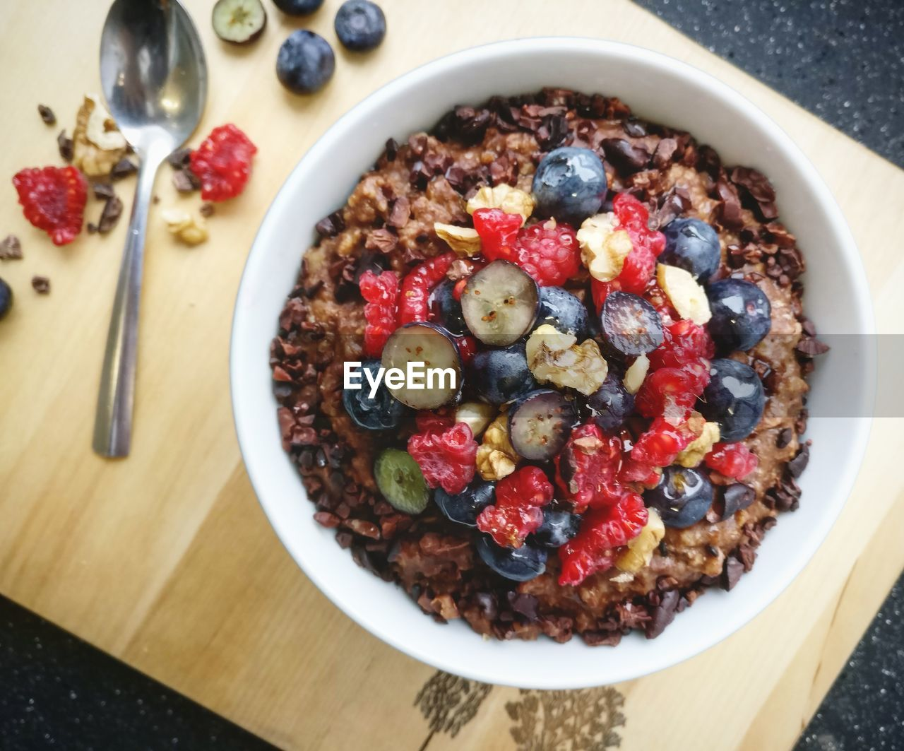 food, food and drink, healthy eating, berry fruit, freshness, wellbeing, bowl, blueberry, fruit, breakfast, table, meal, breakfast cereal, ready-to-eat, high angle view, directly above, eating utensil, kitchen utensil, raspberry, indoors, no people, oats - food, temptation, porridge