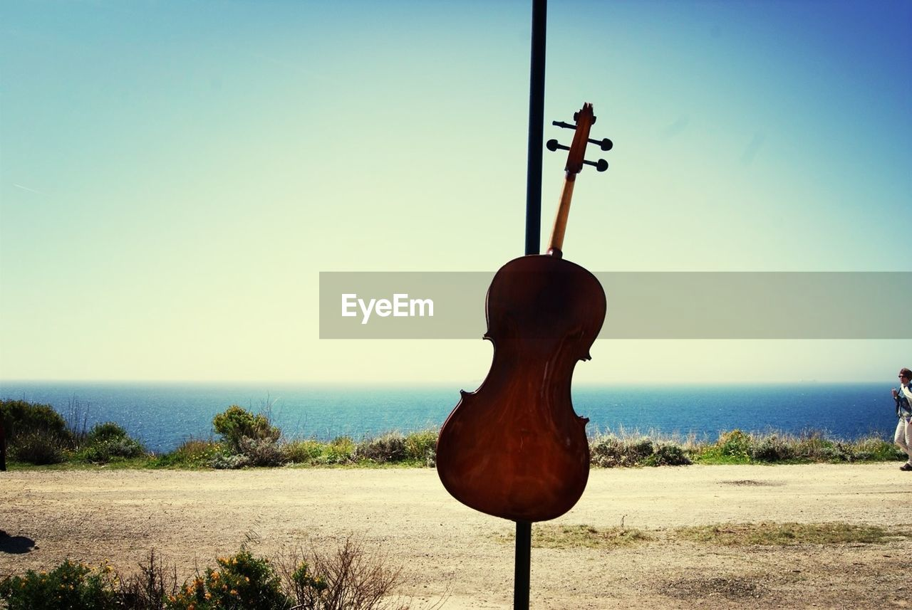 clear sky, sea, horizon over water, tranquil scene, music, nature, no people, day, water, beach, sky, outdoors, scenics, tranquility, sand, musical instrument, beauty in nature