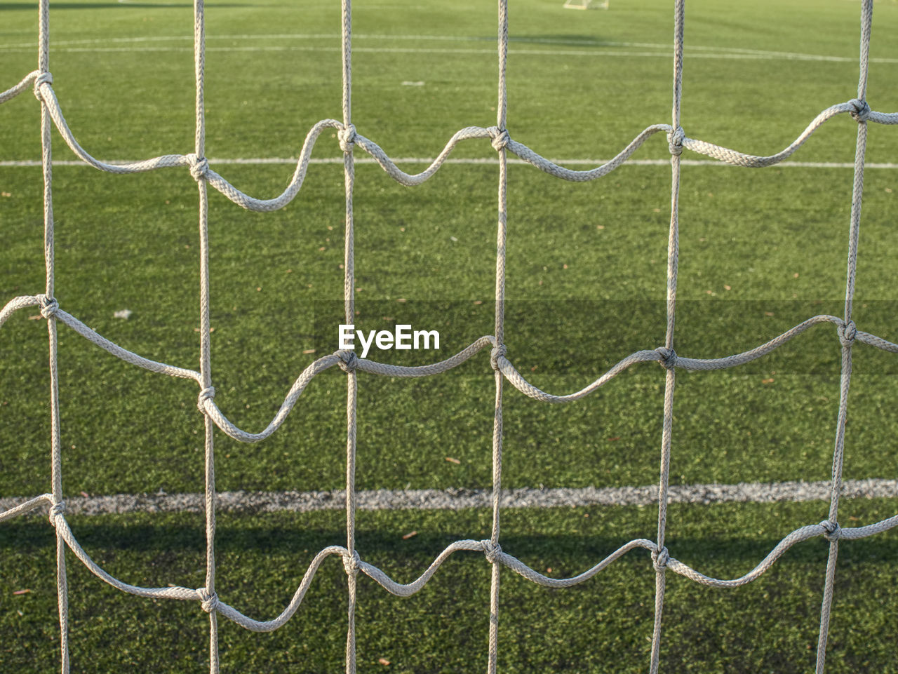 CLOSE-UP OF GREEN SOCCER FIELD