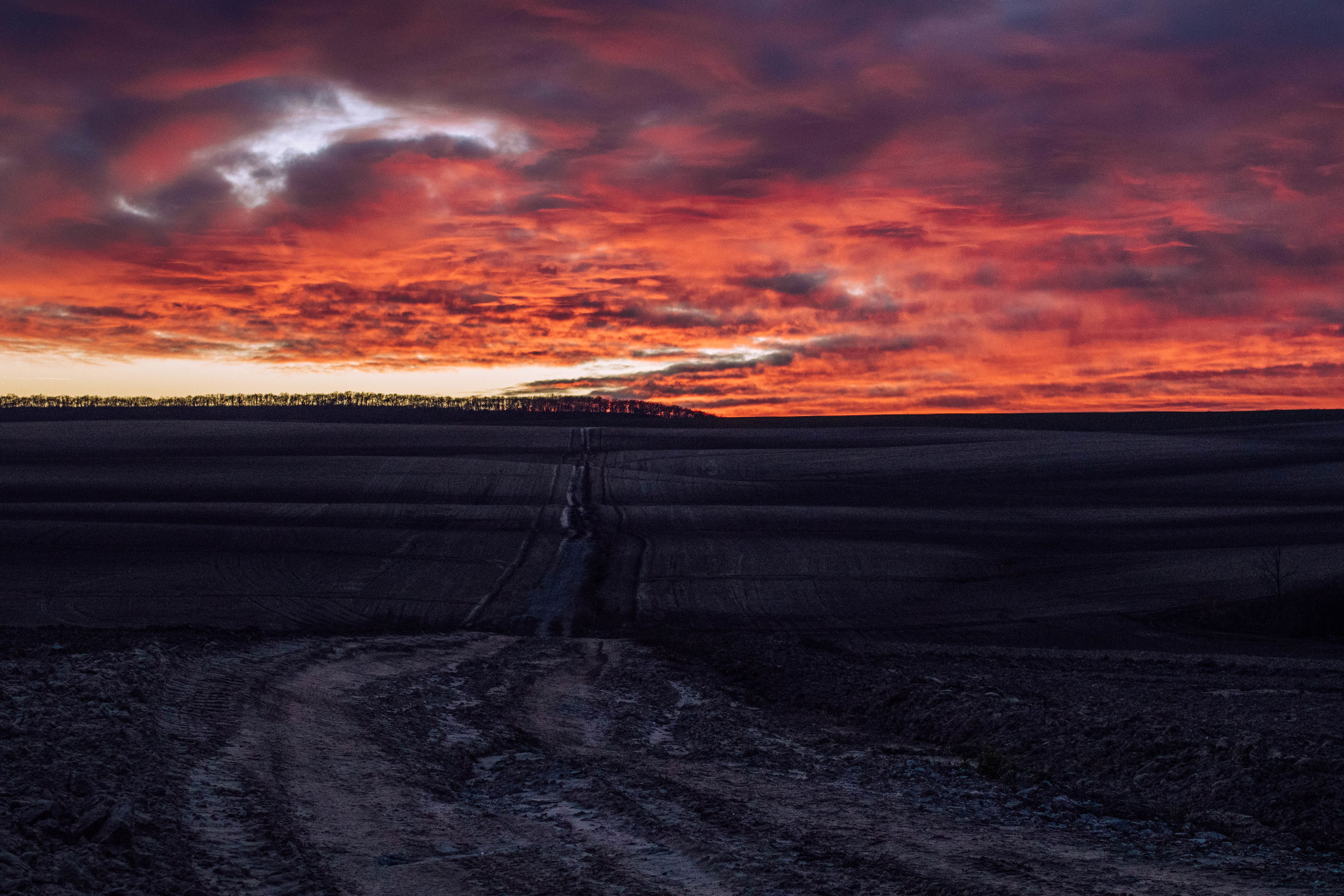 Scenic view of dramatic sky over land
