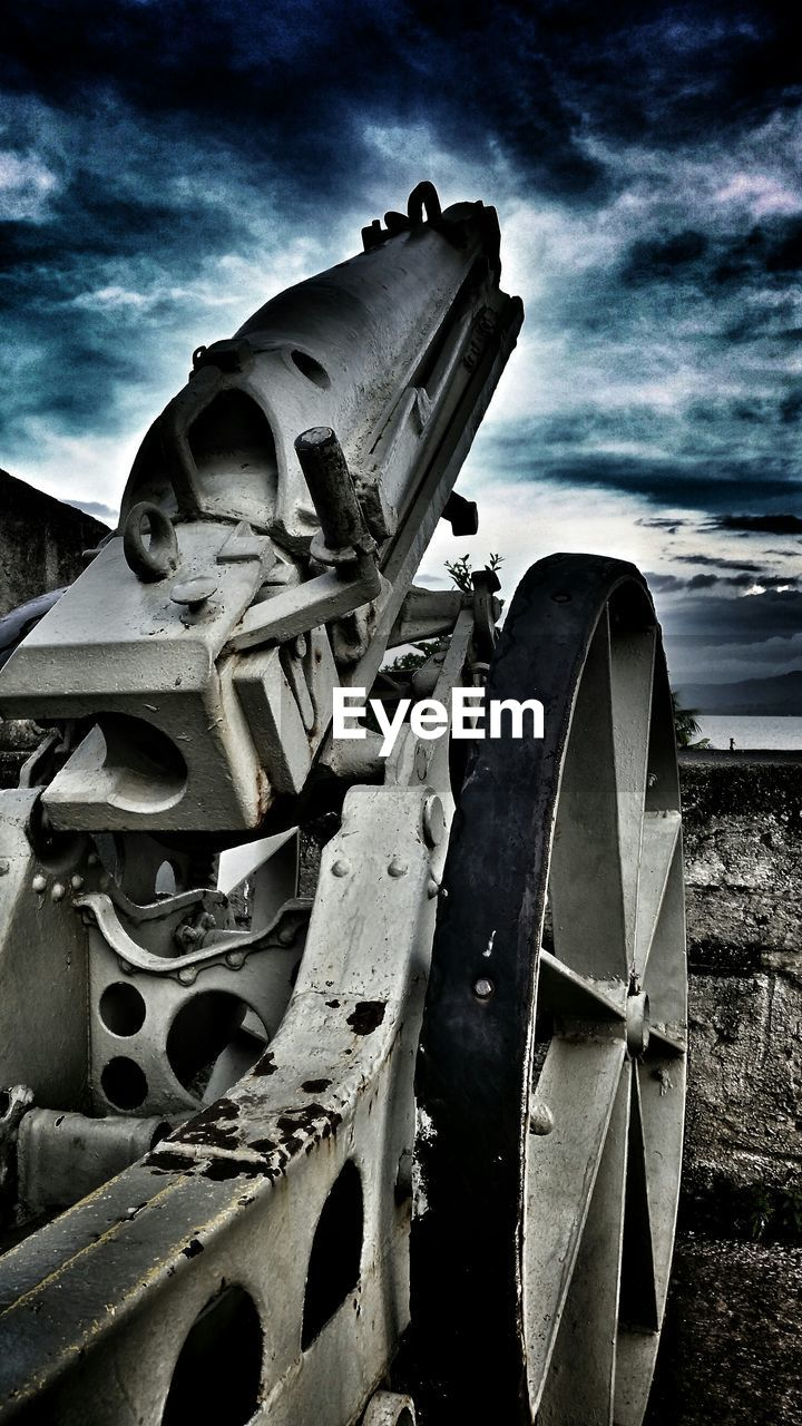 sky, history, weapon, cloud - sky, outdoors, no people, low angle view, canon, day, military, astronomy
