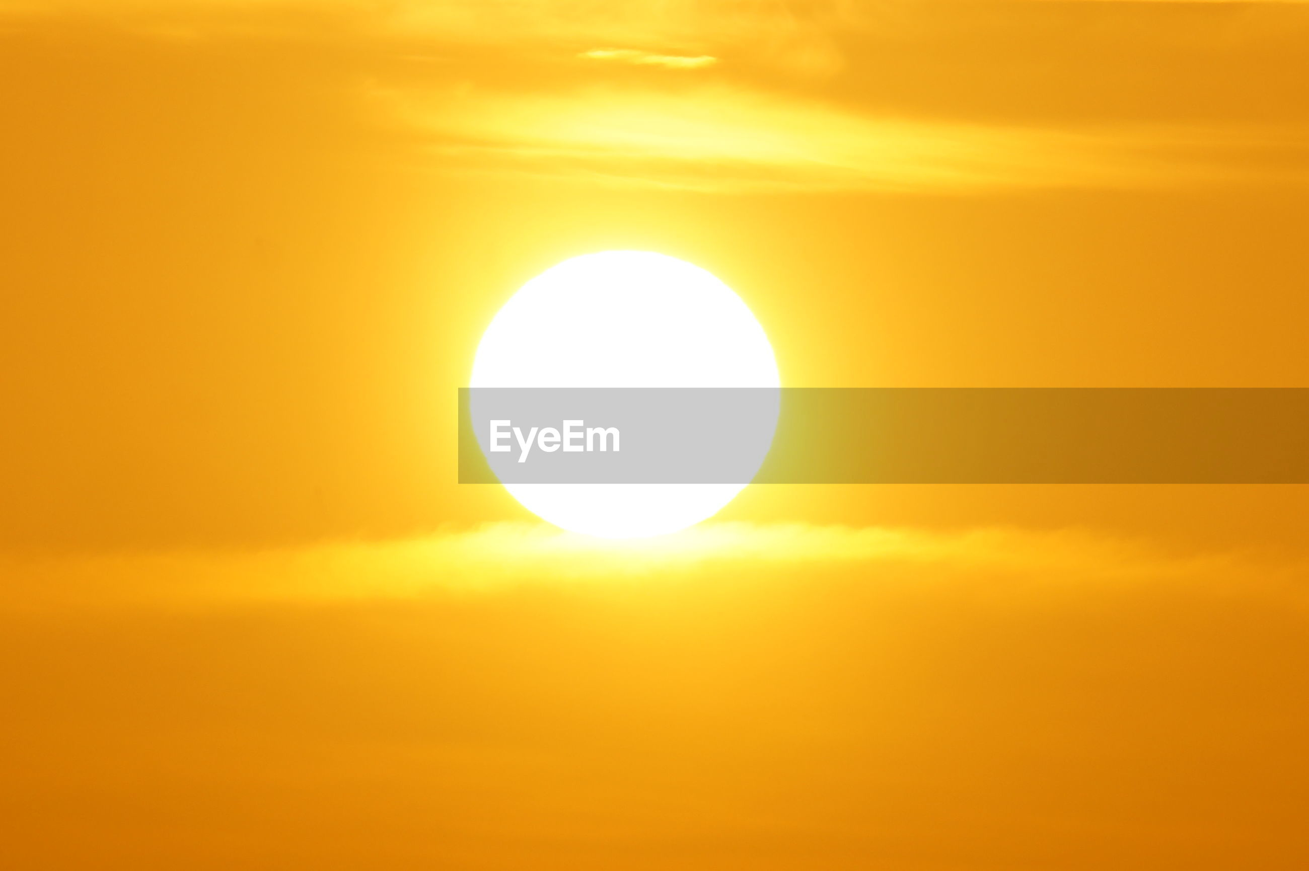 sun, yellow, sunset, orange color, beauty in nature, circle, sky, scenics, cloud - sky, sunlight, nature, bright, outdoors, low angle view, technology, no people, silhouette, solar eclipse, day, close-up