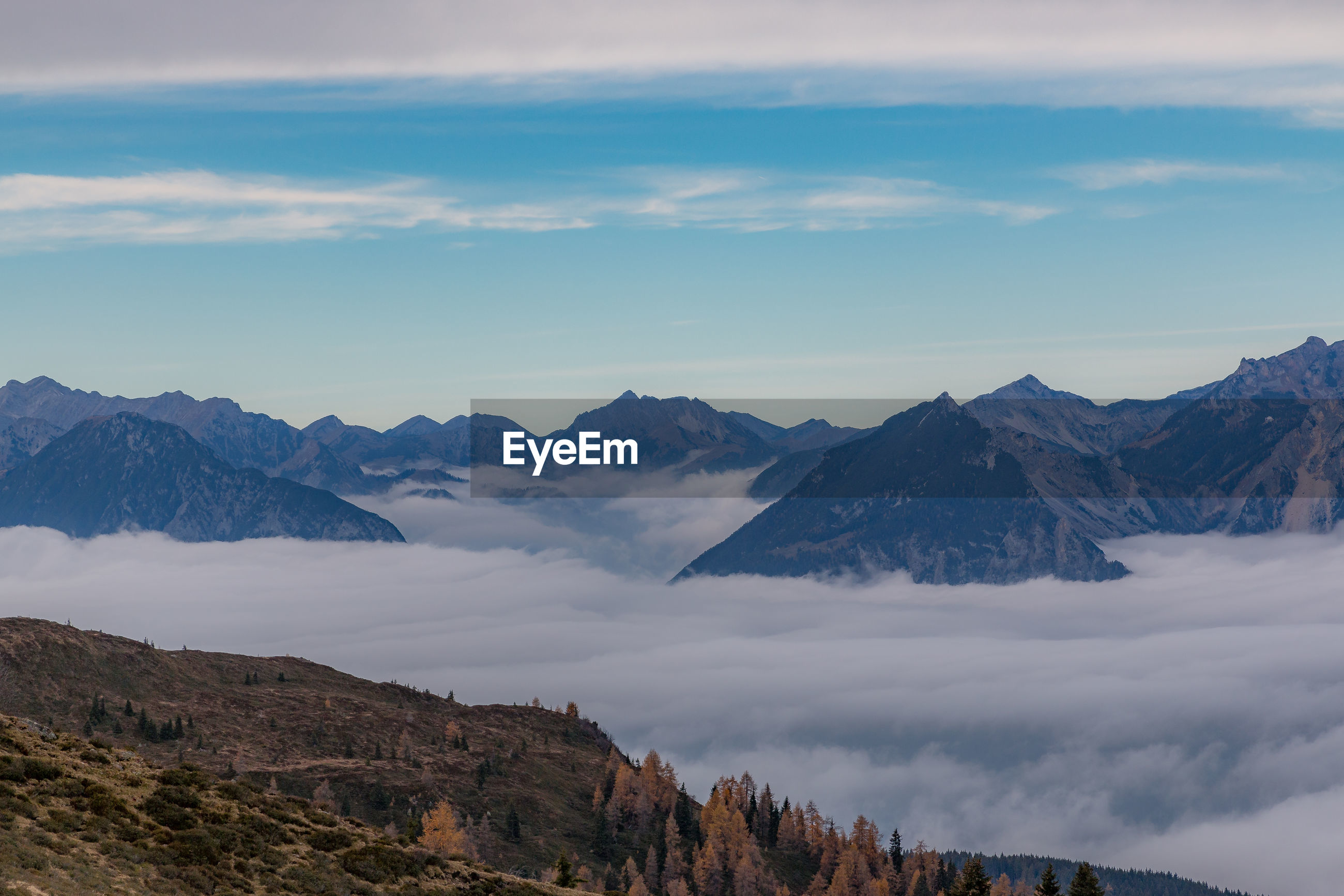 VIEW OF MOUNTAINS AGAINST CLOUDY SKY