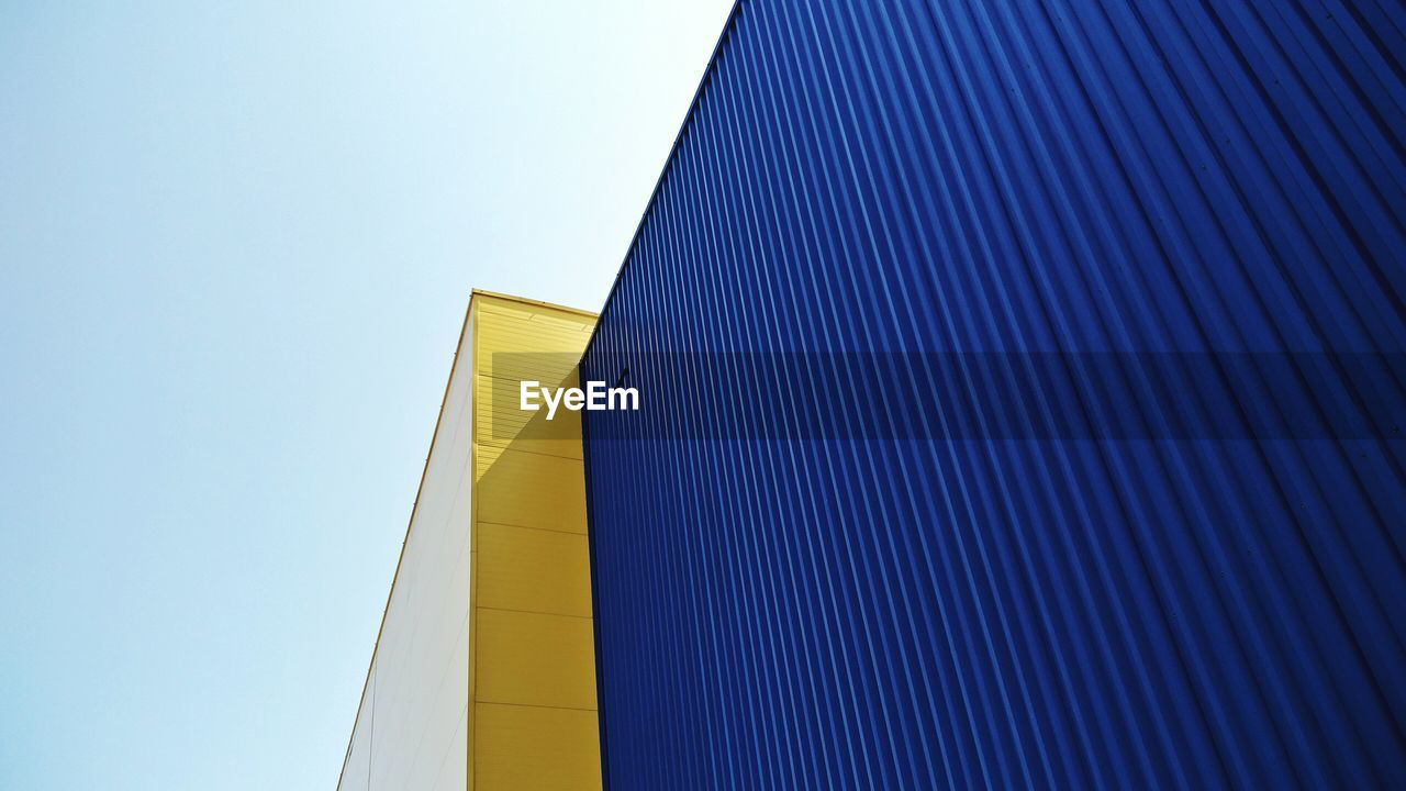 architecture, built structure, low angle view, sky, building exterior, clear sky, blue, building, day, no people, nature, modern, pattern, outdoors, yellow, copy space, office building exterior, city, tall - high, office, skyscraper, directly below