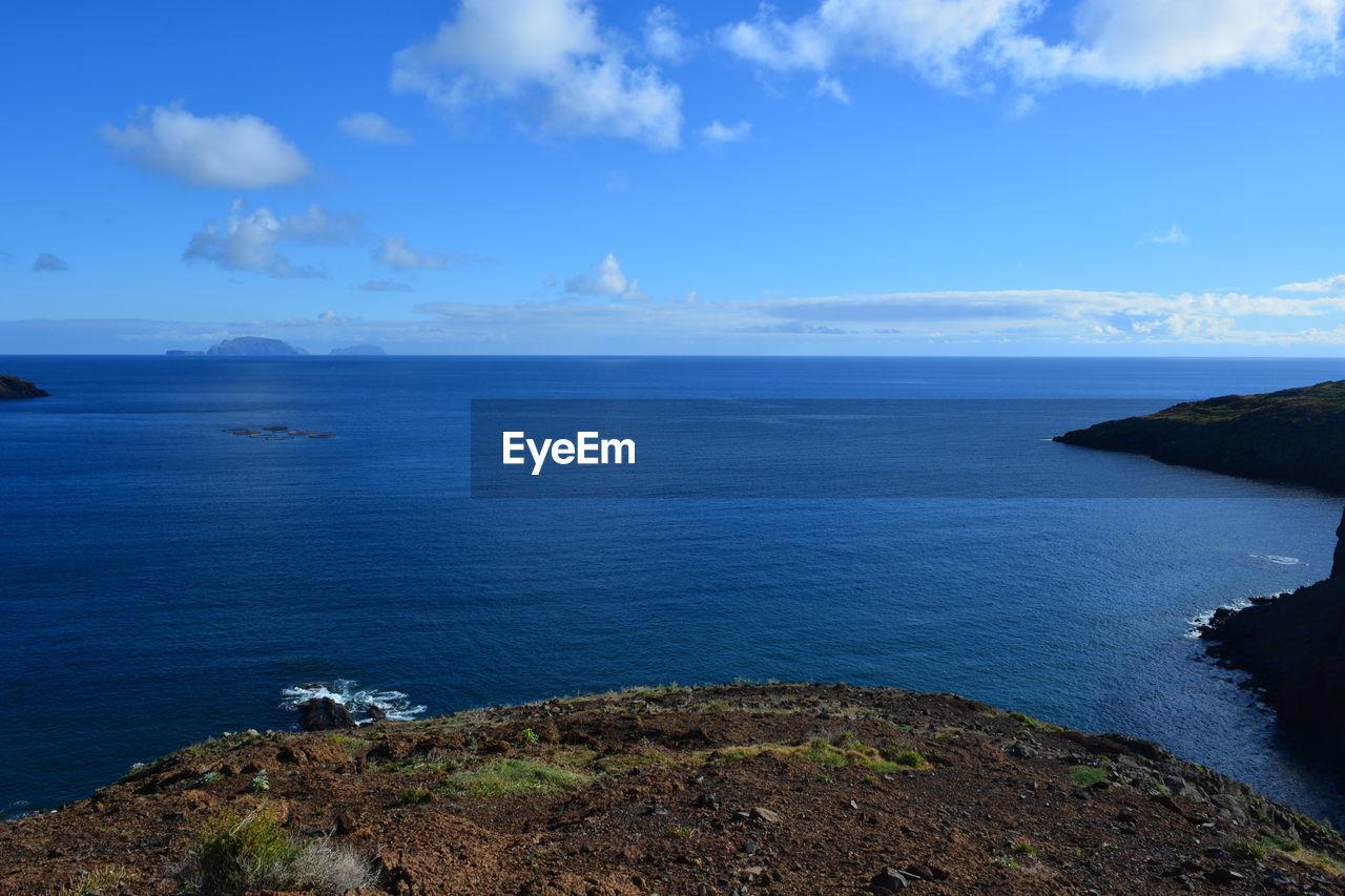 sky, sea, water, scenics - nature, beauty in nature, tranquil scene, cloud - sky, tranquility, horizon over water, horizon, blue, land, nature, idyllic, day, no people, beach, outdoors, non-urban scene, rocky coastline