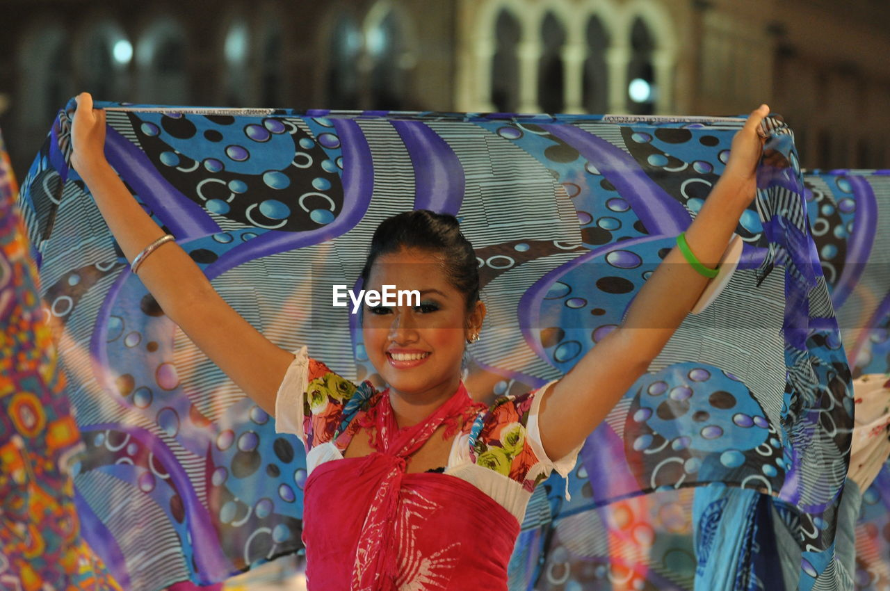 Smiling Artist Performing Traditional Dance With Scarf During Carnival