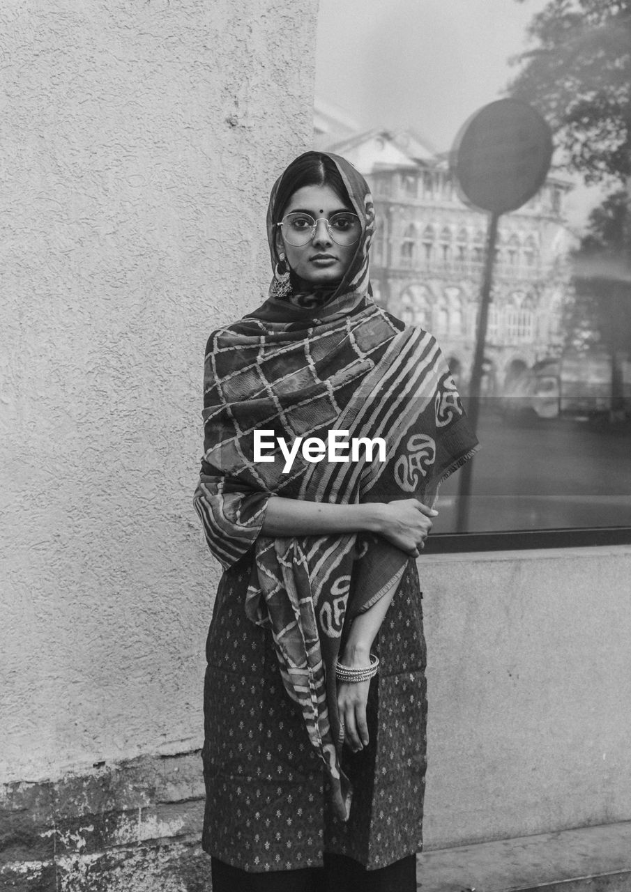 Old portrait of young cultured indian woman standing