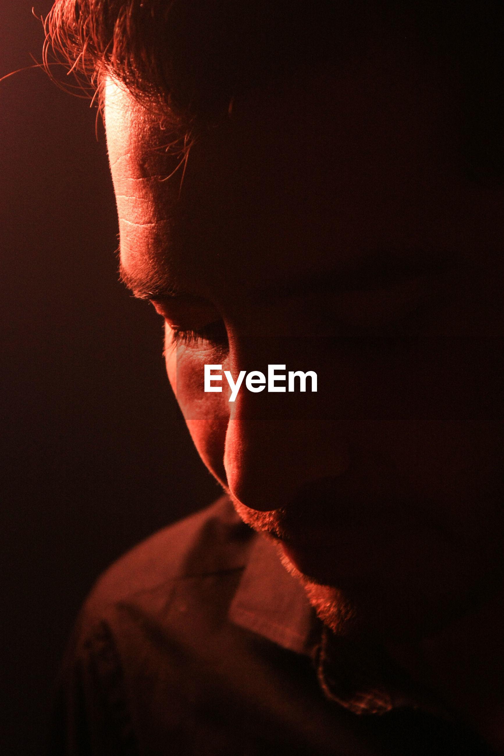 Close-up of man in dark
