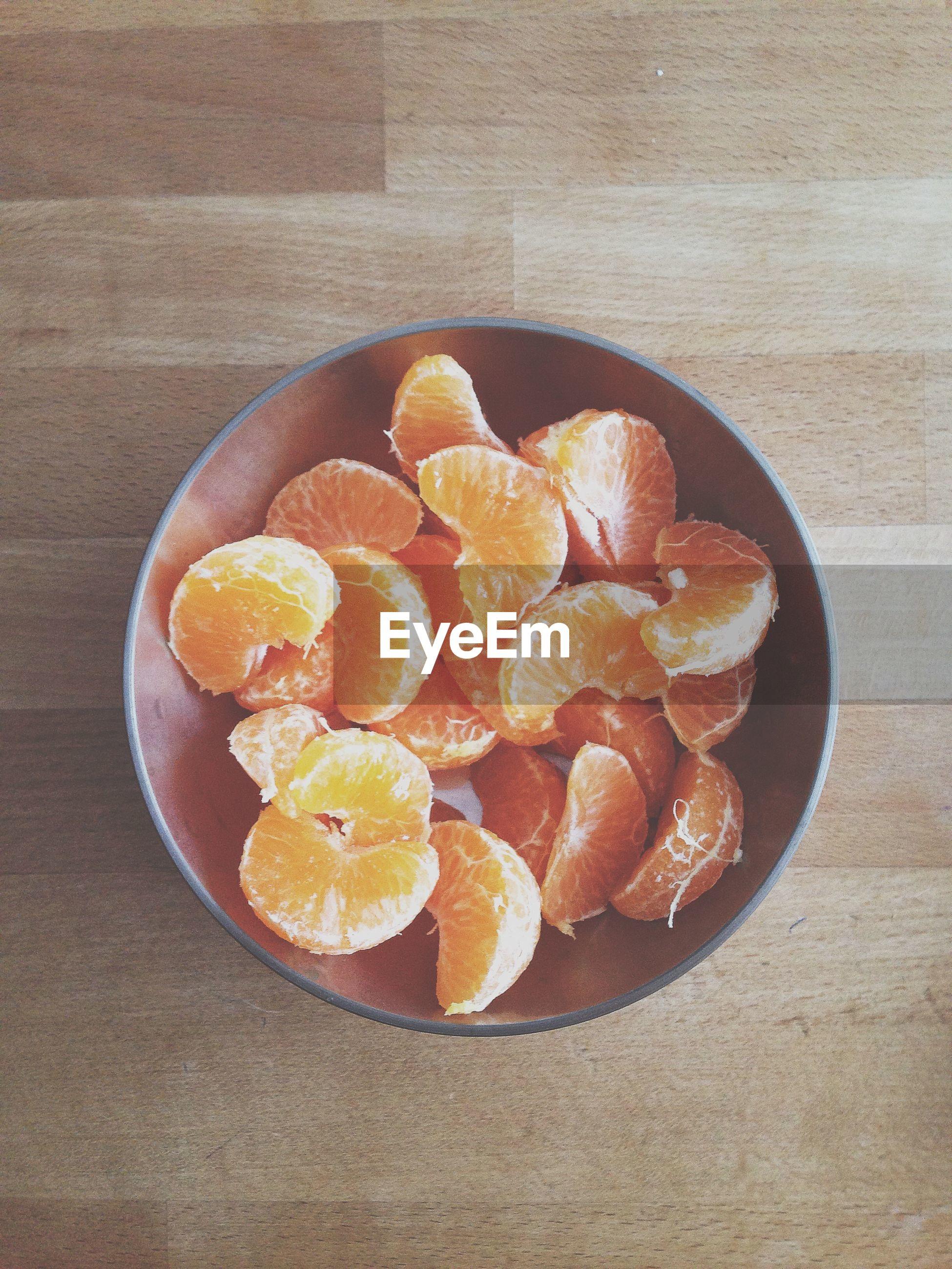 Close-up of peeled orange slices in bowl