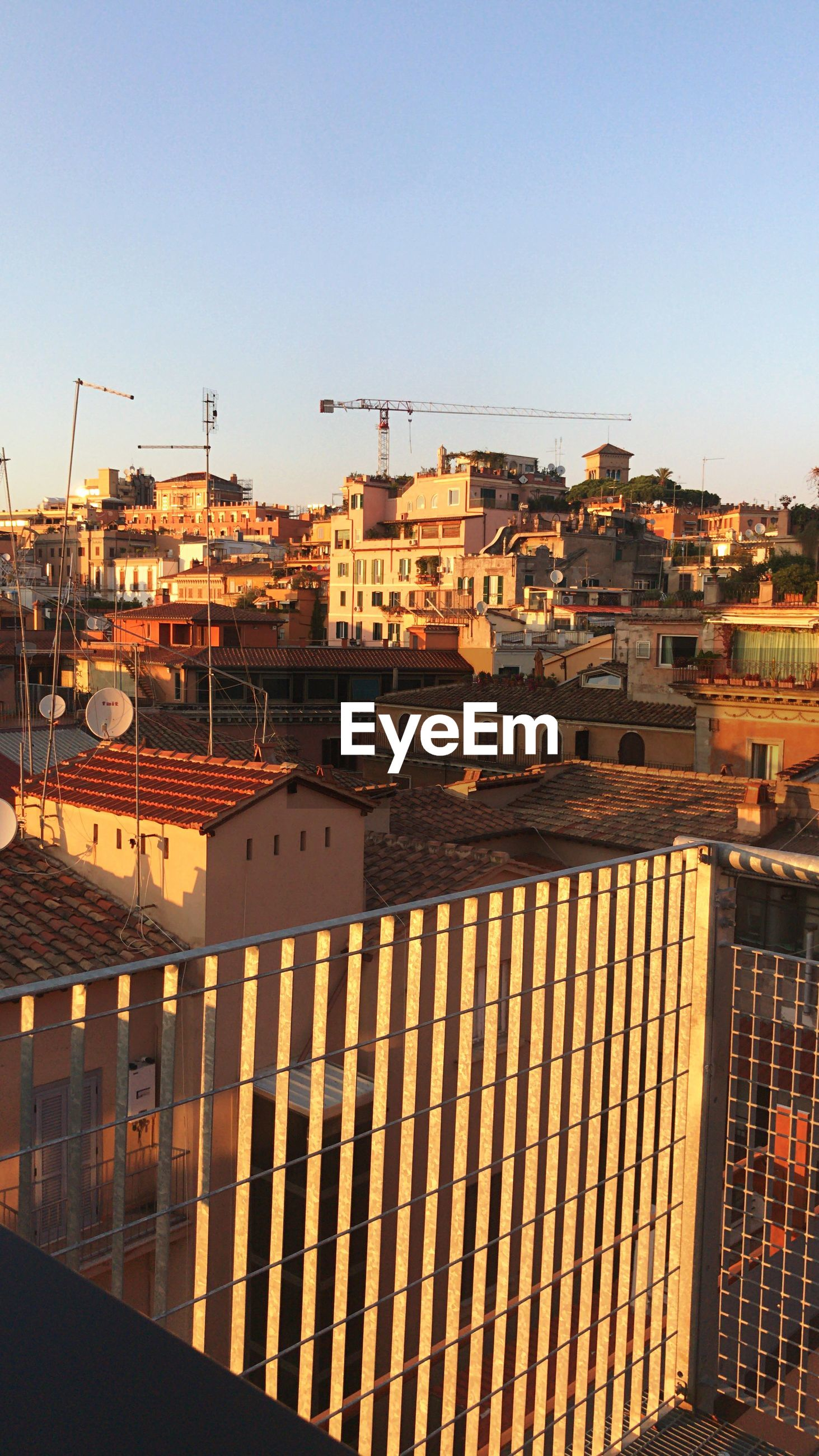 HIGH ANGLE SHOT OF BUILDINGS AGAINST CLEAR SKY