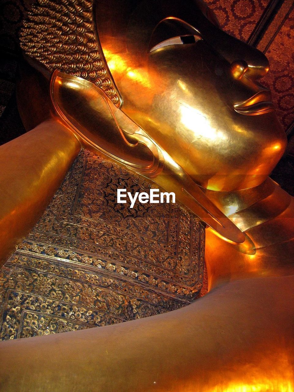 statue, gold colored, sculpture, art and craft, low angle view, spirituality, no people, religion, outdoors, close-up, day