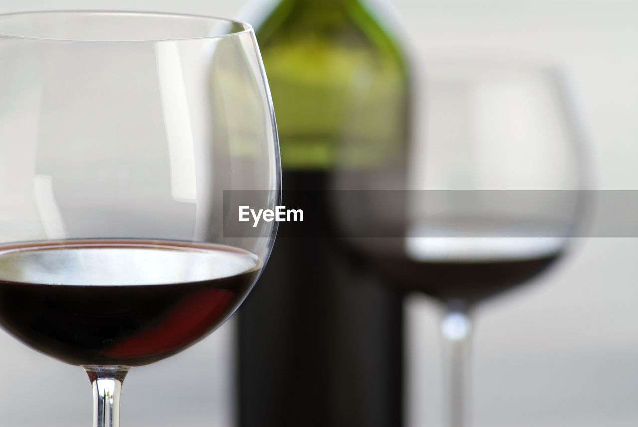 Close-Up Of Red Wine In Glasses And Bottle