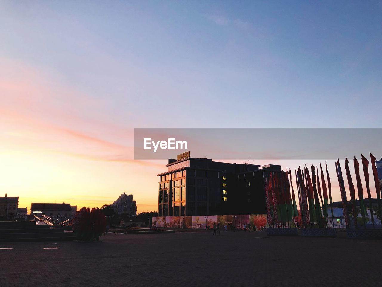 sky, architecture, built structure, building exterior, sunset, city, nature, building, orange color, no people, outdoors, transportation, residential district, clear sky, copy space, street, multi colored, dusk, road