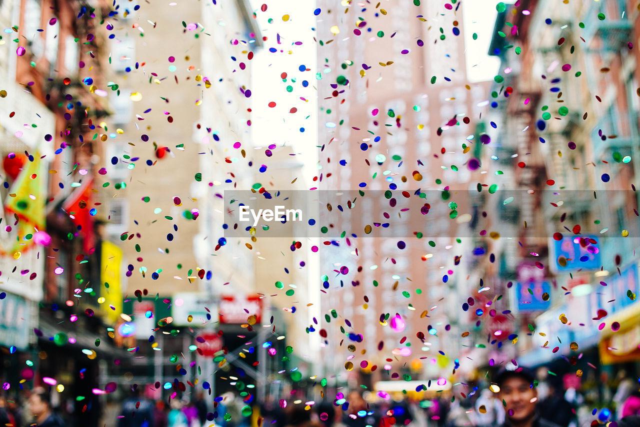 Close-Up Of Multi Colored Confetti In City