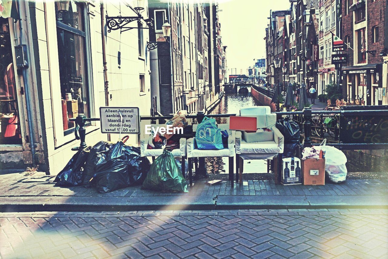 architecture, building exterior, city, built structure, street, men, real people, garbage, day, one person, outdoors, one man only, people