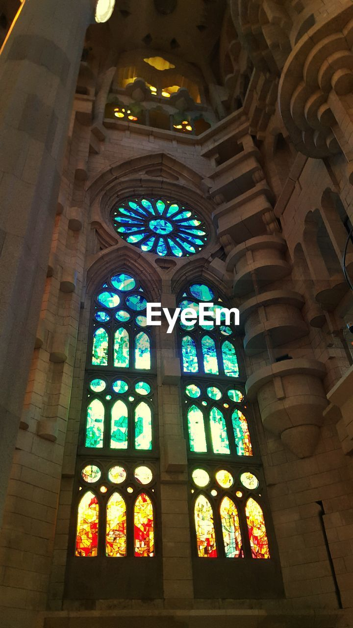 place of worship, religion, indoors, window, spirituality, built structure, architecture, low angle view, no people, multi colored, day