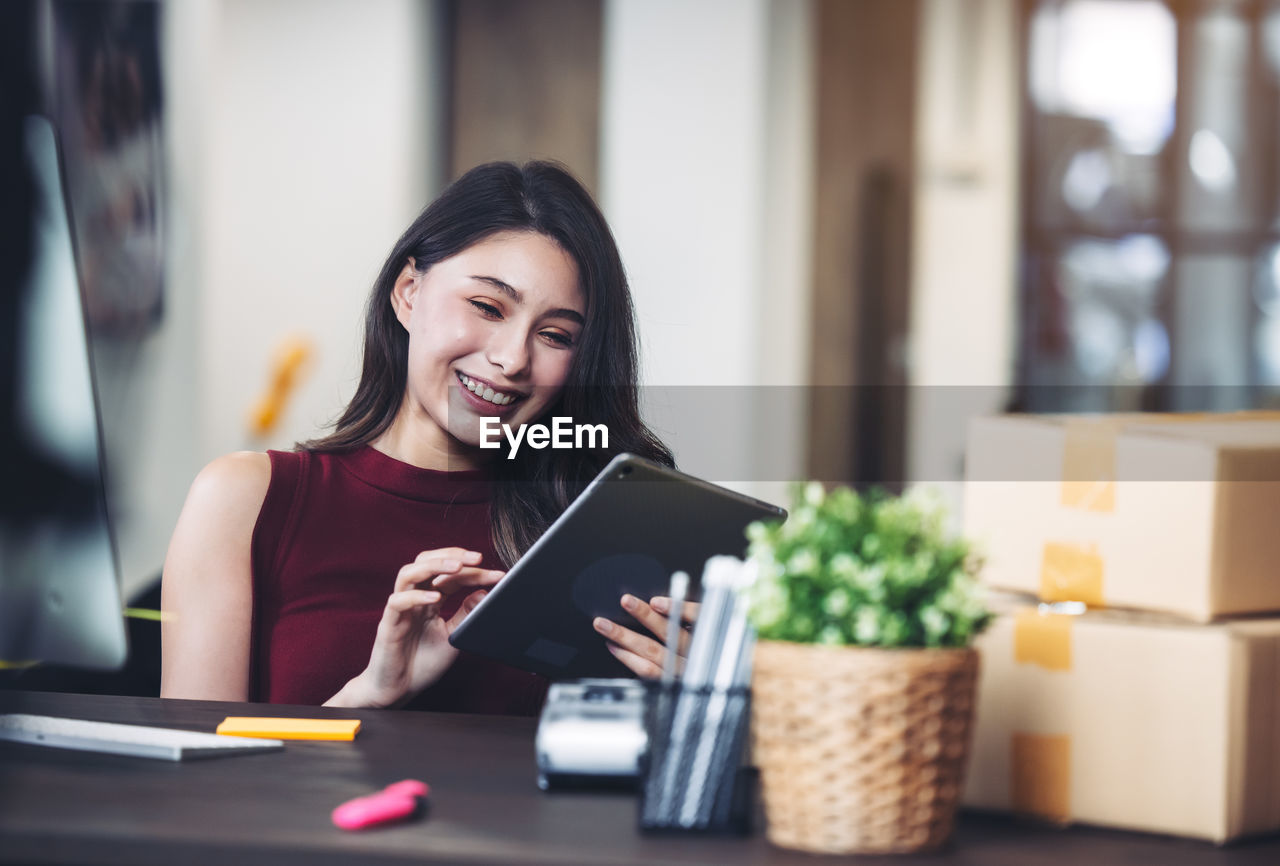 Woman working at home with laptop and mobile phone person