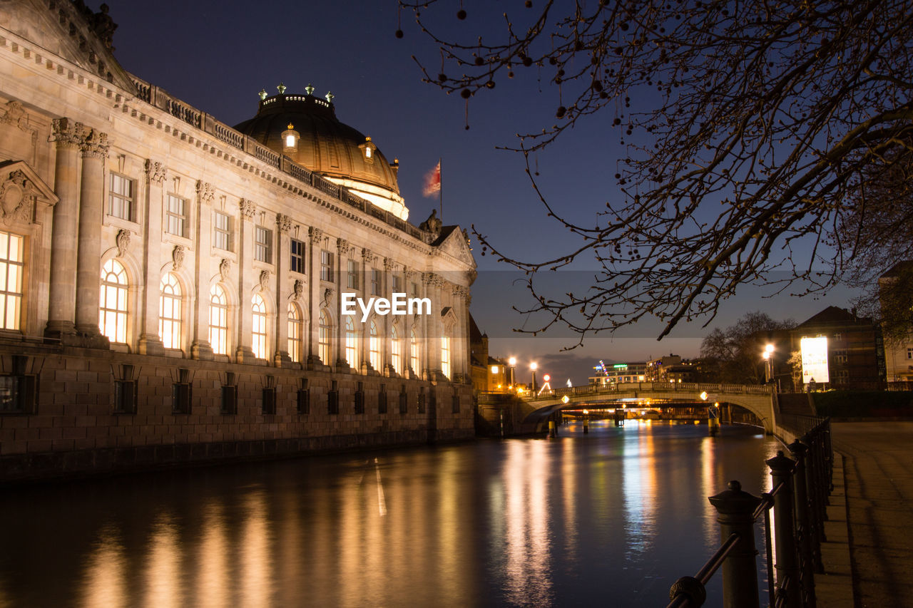 River By Bode Museum In Illuminated City At Night