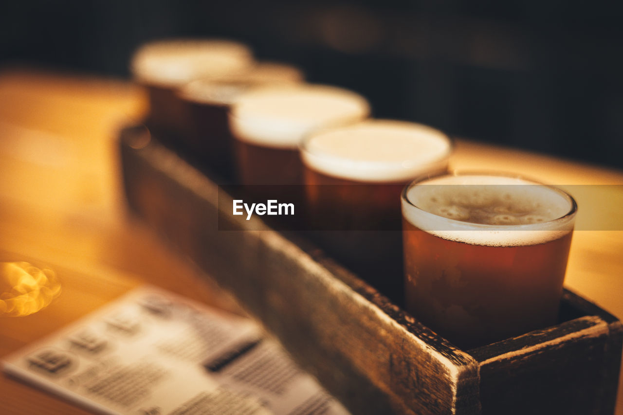 Beer Glasses In Wooden Container On Table At Bar