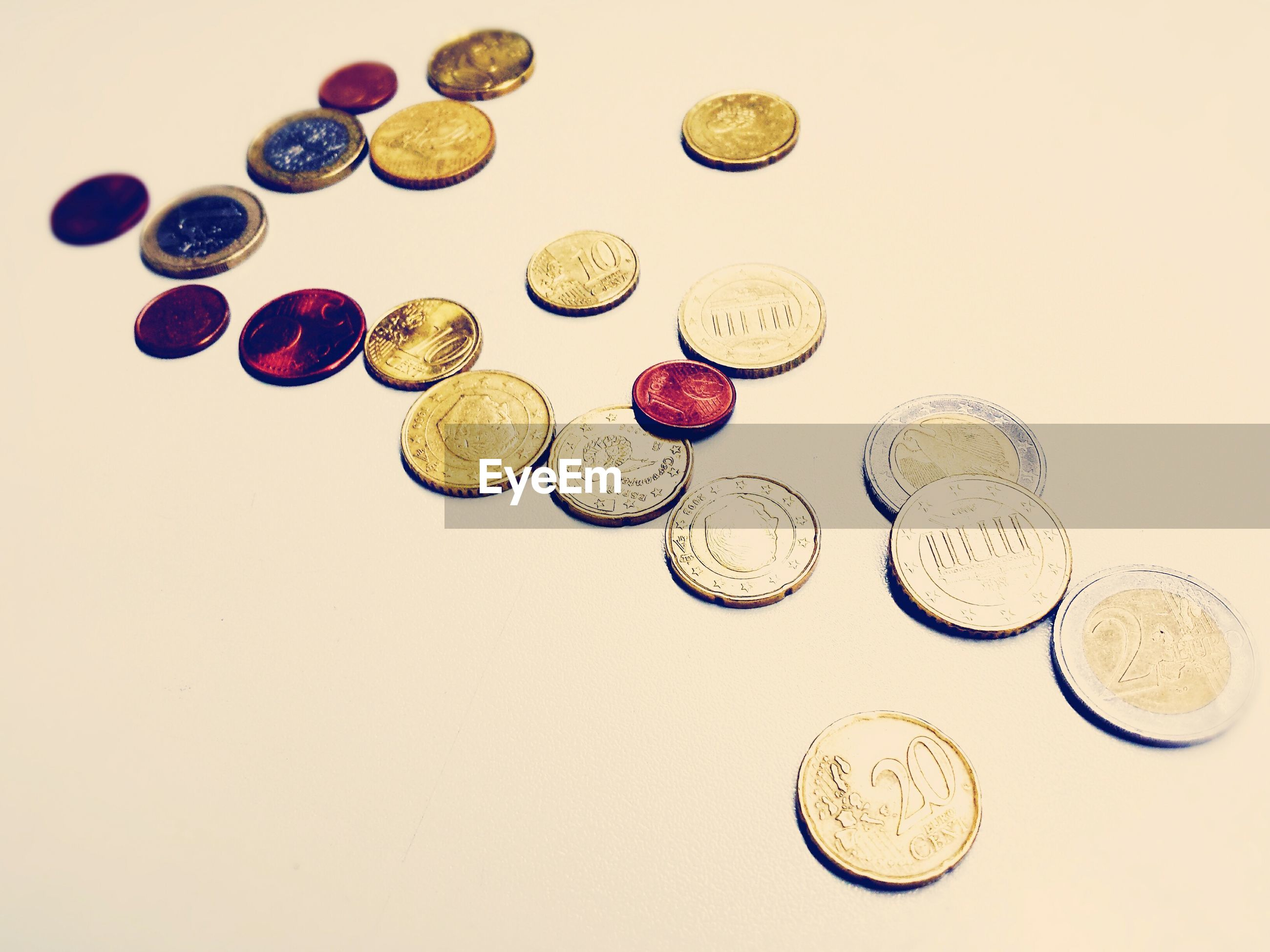 High angle view of european union coins against white background