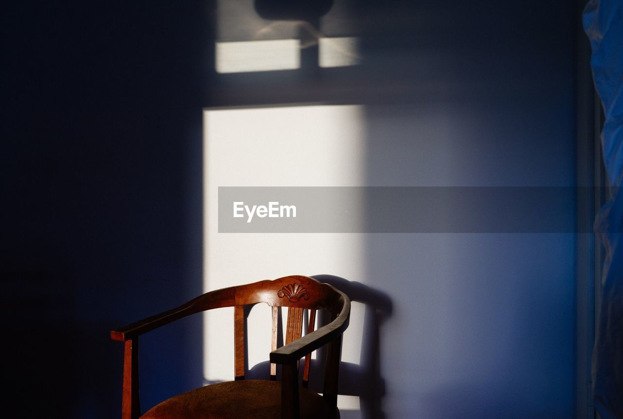 Sunlight on wooden chair at home