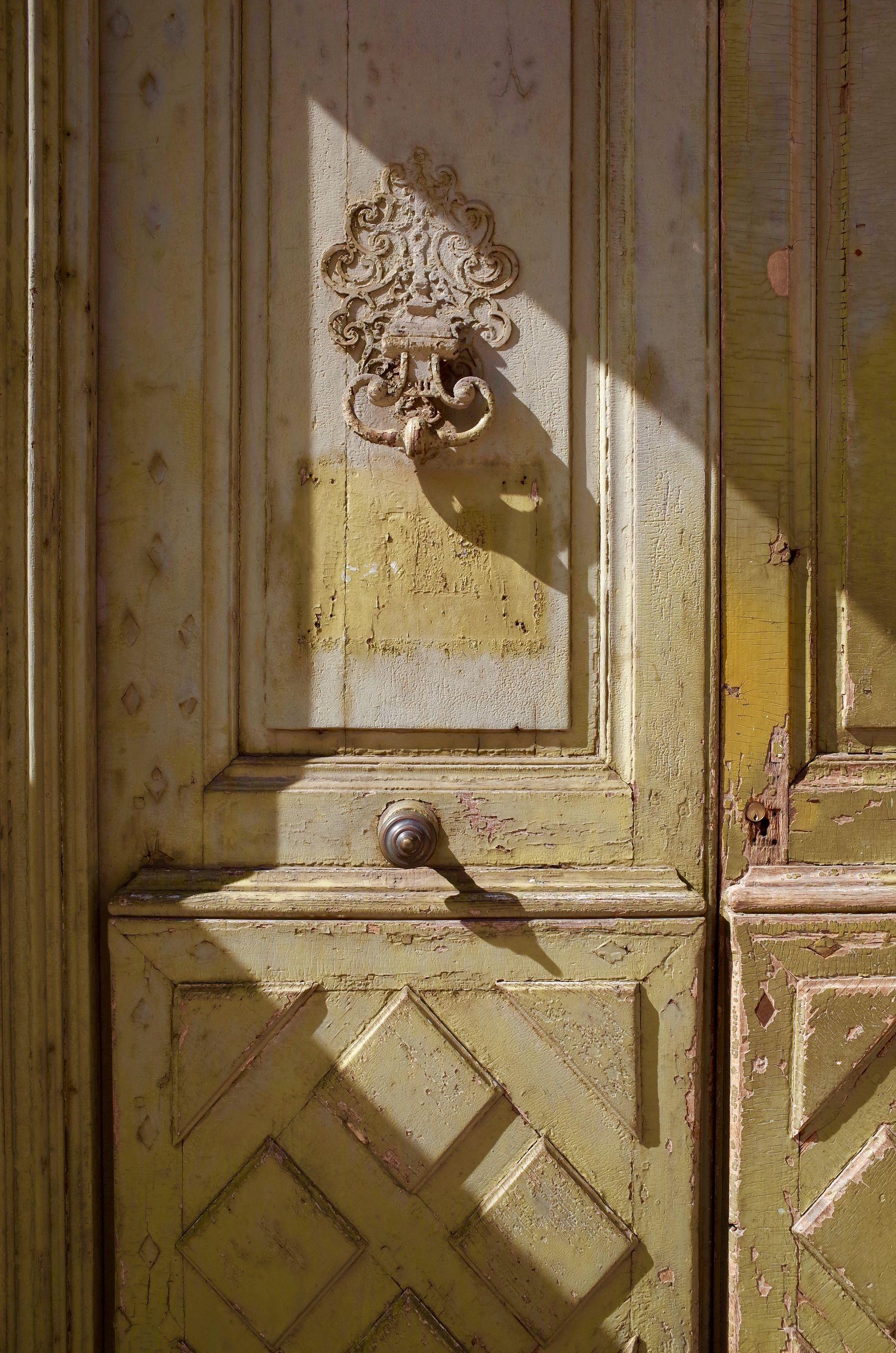 Full frame shot of abandoned closed door