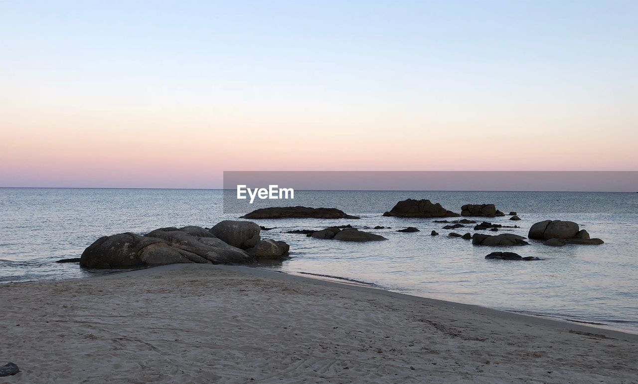 sea, water, sky, horizon over water, rock, horizon, rock - object, beauty in nature, sunset, scenics - nature, solid, beach, tranquil scene, tranquility, land, nature, idyllic, no people, non-urban scene, outdoors